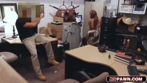 Wet babe is masturbating in her office, in front of a hidden camera, during an office break